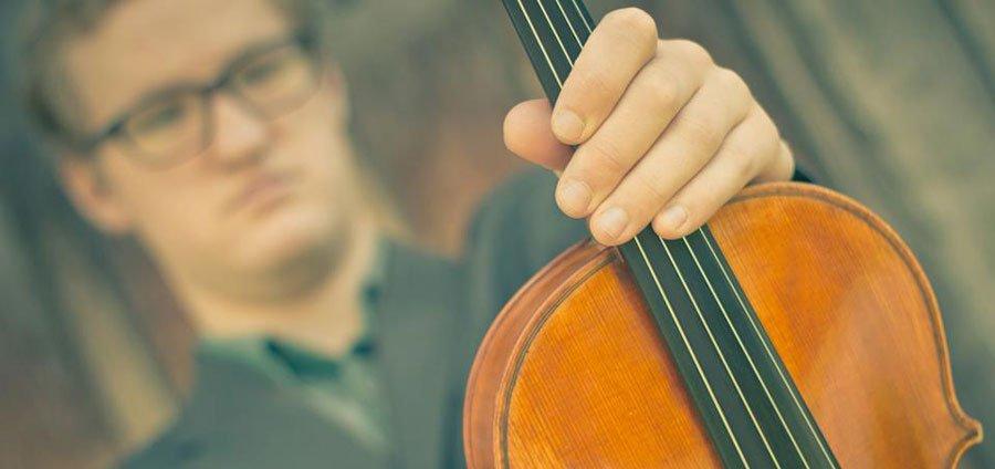 Carl holding his viola