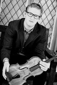 photo of Carl holding his viola